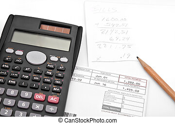 Adding Up Monthly Expenses - A calculator and papers for...