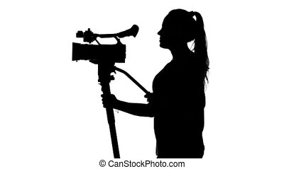 Shooting video or film at the studio. White. Silhouette -...