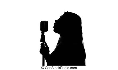 Singer approached the microphone and began to sing. Close...