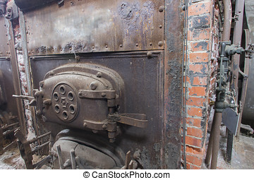 Brick coal burning boiler in machine room - Front of brick...