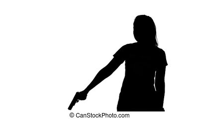 Woman pulls out from behind the gun. Silhouette. White -...