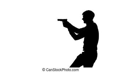 Man pointing a gun. Silhouette. White - Man moves around the...