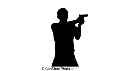 Man takes aim and fires his gun. Silhouette. White - Man...