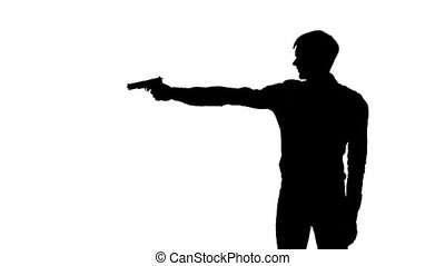 Man raises the gun and blows the barrel. Silhouette. White -...