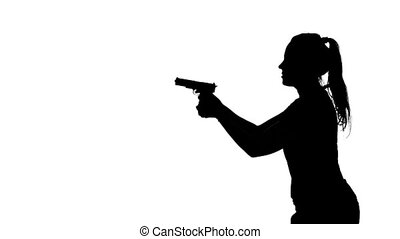 Woman pointing a gun. Silhouette. White - Woman moves around...