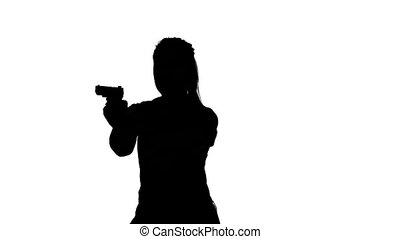 Woman takes aim and fires his gun. Silhouette. White - Woman...