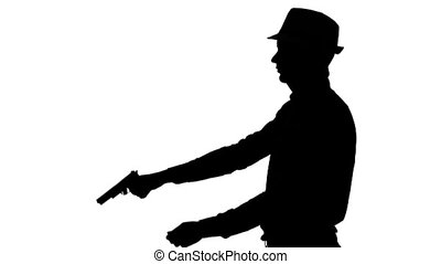 Man in the hat makes a shot from a pistol. Silhouette. White