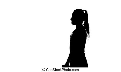 Woman shoots a gun. Silhouette. White - Woman shoots a gun,...