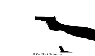 Hands loading a gun and shooting. Silhouette. White - Man...