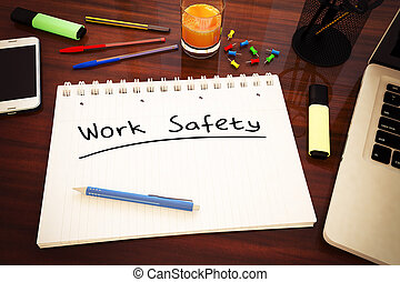Work Safety - handwritten text in a notebook on a desk - 3d...