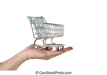 man hand holding in palm little metal shopping trolley in...