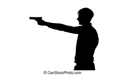 Man charges the clip gun. Silhouette. White - Young man...