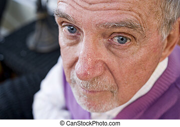 Face of serious elderly man staring at camera - Face of...