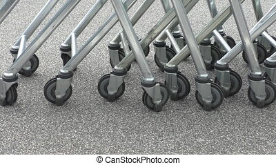 Row of shopping trolleys or carts - Retail store shopping...