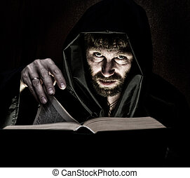 necromancer casts spells from thick ancient book by...