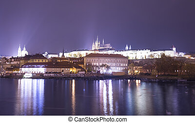 Night view of Prague, Czech Republic: river Vltava, Hradcany, castle and St. Vitus Cathedral