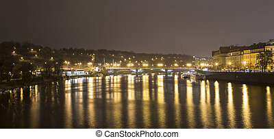 A night view of the river Vltava in Prague, Czech Republic