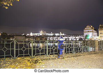 Embankment of the Vltava River near Charles Bridge, night...