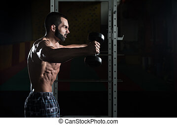 Young Man With Dumbbells Exercising Shoulders - Young Man...