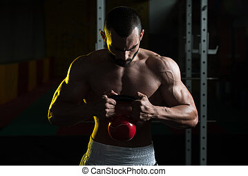 Kettle Bell Exercise - Young Man Working With Kettle Bell In...