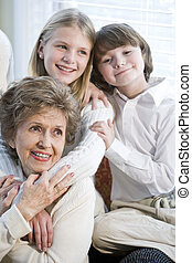 Close up portrait of children with grandmother together