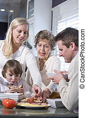 Grandmother with family eating lunch in kitchen