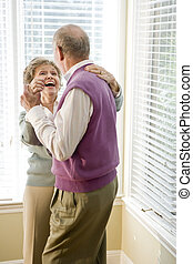 Loving senior couple dancing in living room - Happy senior...