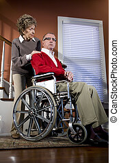 Senior couple at home, man in wheelchair - Serious senior...