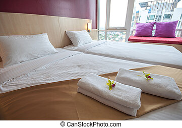 Beautiful bedroom interior and towels