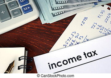 Income tax written on a paper. Financial concept.