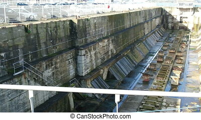 Industrial dam view near parking. View inside without water