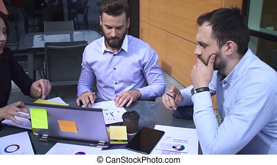 Meeting between business people on a table