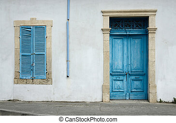 Photo of typical Cypriot old aged white building with bright...