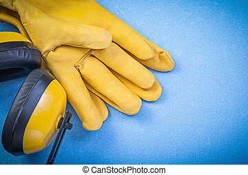 Set of protective workwear on blue background construction...