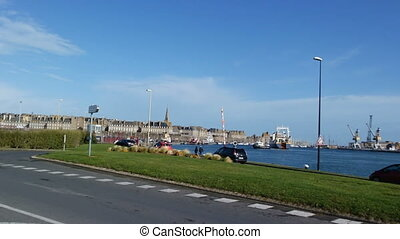 SAINT MALO, FRANCE - March 25, 2016: view of City wall view from the town. Cars driving on a road near a sea port