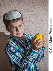 The boy in knitted kippah is holding etrog - Very beautiful...
