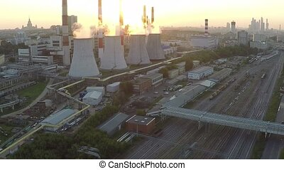 Industrial area and railroad tracks at sunset. Aerial view...