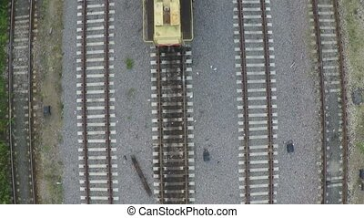 Multiple railroad tracks and railroad crane aerial view clip