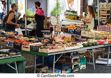 Farmer selling organic products in Campo dei Fiori, famous...