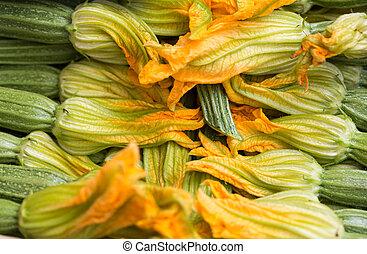 fresh zucchini flowers at the farmers market