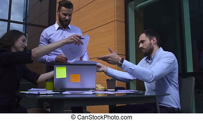 Boss showing his employees a document