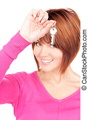 happy woman with keys - picture of happy woman with keys...