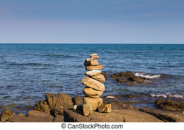 Stack rock over rocky beach skyline, natural landscape...