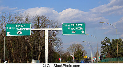 Road Sign in the highway junction in Northen Italy to go to...