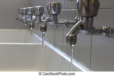 long rows of taps in the bathroom of kindergarteners - rows...