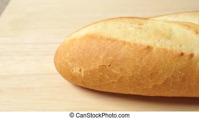 French bread baguette horizontal close up dolly shot -...