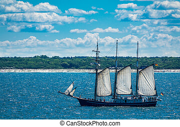 A sailing ship on the Baltic Sea with blue sky