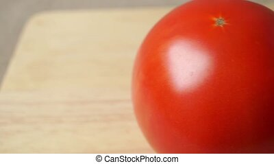Two whole red tomatoes close up dolly shot