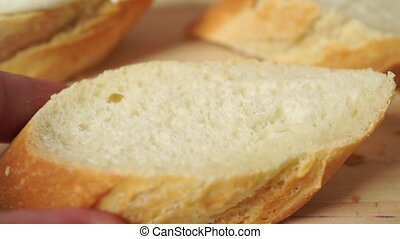 Spreading butter on a piece of wheat bread, close up clip