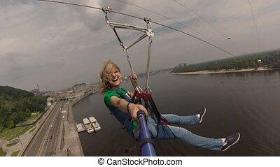 Selfie girl ftom trolley across the river